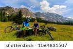mountain cycling couple with... | Shutterstock . vector #1064831507