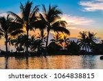 tropical paradise sunset... | Shutterstock . vector #1064838815