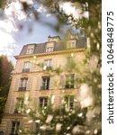 beautiful parisian building... | Shutterstock . vector #1064848775