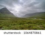 A view of the Scottish highlands, cloudy sky and highway A82, running from the west coast to Glascow.