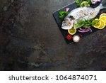 fresh fish dorado. raw dorado... | Shutterstock . vector #1064874071