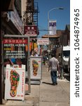 Small photo of Philadelphia, Pennsylvania, USA – August 3, 2016: Vertical shot of the colorful sign of a foot reflexology center in 10th St, Chinatown, Philadelphia, Pennsylvania