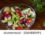fresh vegetable salad and ripe... | Shutterstock . vector #1064880491