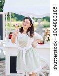a cheerful ice cream saleswoman ... | Shutterstock . vector #1064883185