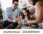 happy family having fun time at ... | Shutterstock . vector #1064884064