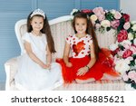 two little beautiful princesses ... | Shutterstock . vector #1064885621