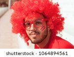 portrait of fan with red wig...   Shutterstock . vector #1064894561