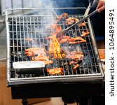 Small photo of Summer BBQ grilling marinated pork on fire, traditional Korean style. Korean barbecue is Korean style grilling meat, usually use thinly sliced traditionally marinated and unmarinated meat dishes.
