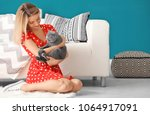young woman with cute pet cat... | Shutterstock . vector #1064917091