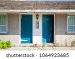 room doors of an abandoned... | Shutterstock . vector #1064923685
