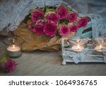 fresh rose bunch with candle... | Shutterstock . vector #1064936765