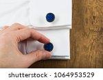 cufflinks with shirt on the... | Shutterstock . vector #1064953529