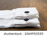cufflinks with shirt on the... | Shutterstock . vector #1064953535