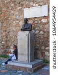 Small photo of MALAGA, SPAIN - MARCH 28, 2016: A bard is playing a guitar at the monument to Juan Temboury Alvarez