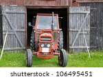 an antique tractor parked in...