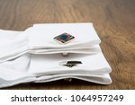 cufflinks with shirt on the... | Shutterstock . vector #1064957249