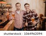 friends met after a hard day.... | Shutterstock . vector #1064962094