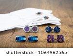 cufflinks with shirt on the... | Shutterstock . vector #1064962565