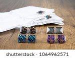 cufflinks with shirt on the... | Shutterstock . vector #1064962571