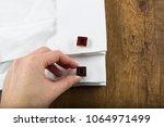 cufflinks with shirt on the... | Shutterstock . vector #1064971499