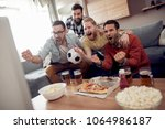 soccer fans watching game in... | Shutterstock . vector #1064986187