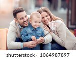 happy family.father mother and... | Shutterstock . vector #1064987897