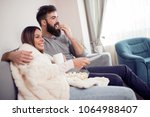 happy couple watching...   Shutterstock . vector #1064988407