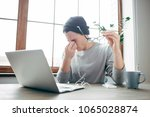 young hipster is sitting at the ...   Shutterstock . vector #1065028874