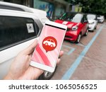 smart phone and sharing car | Shutterstock . vector #1065056525