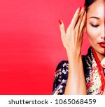 young pretty geisha on red...   Shutterstock . vector #1065068459