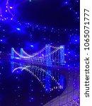 blue light bulb in the dark... | Shutterstock . vector #1065071777
