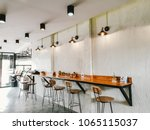 Stock photo empty on people coffee shop interior design with chairs and white walls 1065115037