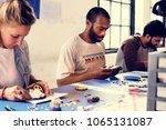 group of people working at... | Shutterstock . vector #1065131087
