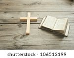 old holy bible and wood cross, rustic wooden table - stock photo