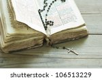 Old Holy Bible And Rosary Bead...