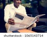 african descent man sitting... | Shutterstock . vector #1065143714