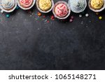 sweet cupcakes with colorful... | Shutterstock . vector #1065148271