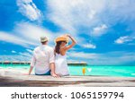 back view of couple sitting on... | Shutterstock . vector #1065159794