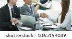 business woman shaking hands... | Shutterstock . vector #1065194039