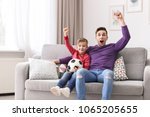 dad and his son watching... | Shutterstock . vector #1065205655