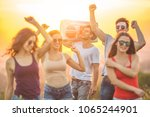 the happy people dancing with a ... | Shutterstock . vector #1065244901