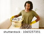 portrait of housewife with... | Shutterstock . vector #1065257351