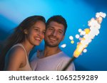 the smile couple hold a... | Shutterstock . vector #1065259289