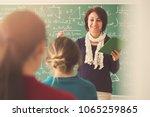 teacher giving lesson to... | Shutterstock . vector #1065259865