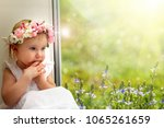 the child is looking in the... | Shutterstock . vector #1065261659