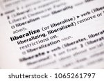 Small photo of Close up to the dictionary definition of Liberalize