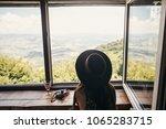 stylish girl traveler ih hat... | Shutterstock . vector #1065283715