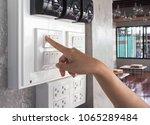 finger is turning on one  light ... | Shutterstock . vector #1065289484