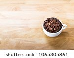 coffee beans in white cup on... | Shutterstock . vector #1065305861