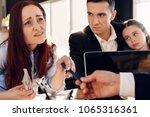 disgruntled woman takes pen... | Shutterstock . vector #1065316361